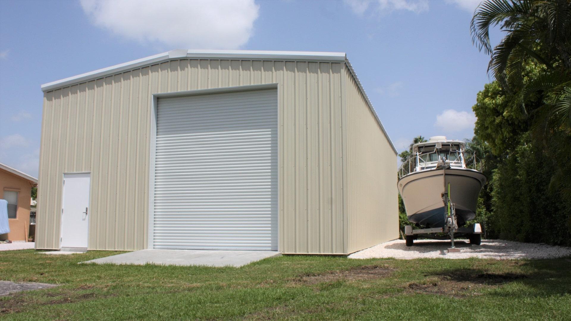 Tan metal building for RV storage with large rollup door and walk door.