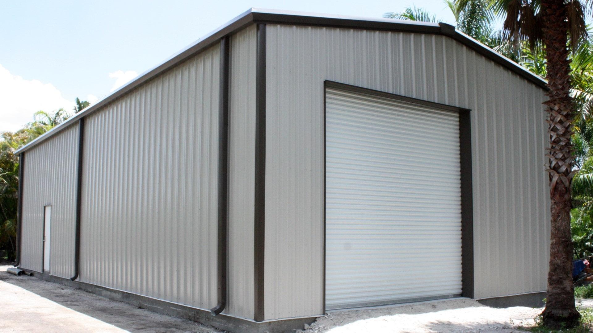 RV storage steel building kit with brown trim, walk door, and large rollup door.